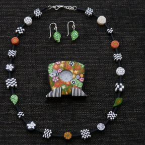 clock pin, necklace and earrings
