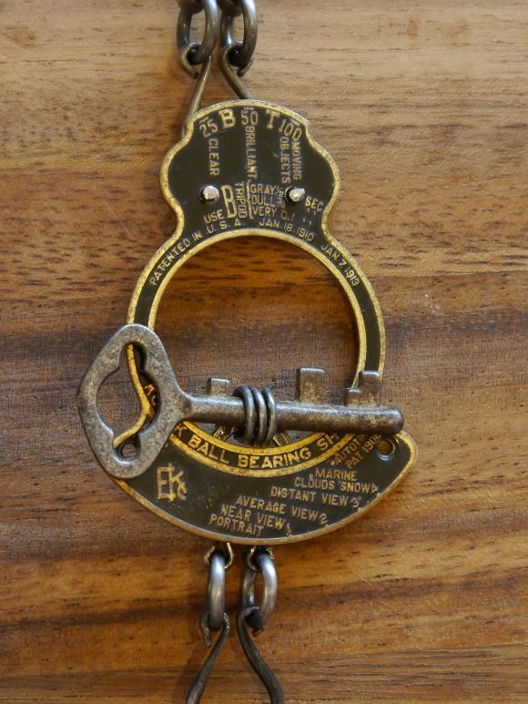 Closure - vintage kodak camera part & vintage key
